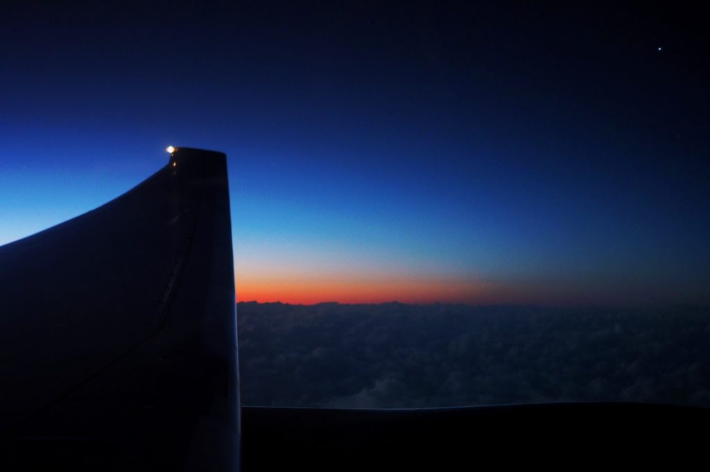 Flying into sunrise over the pacific